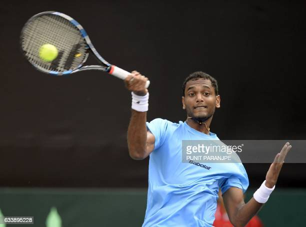 India's Ramkumar Ramanathan returns a shot during the Davis Cup singles tennis match against New Zealand's Finn Tearney at the Balewadi Sports...