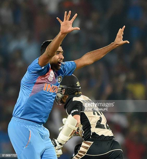 India's Ravichandran Ashwin appeals successfully for taking the wicket of New Zealand batsman Martin Guptill during the World T20 cricket tournament...