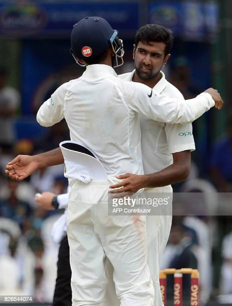 India's Ravichandran Ashwin celebrates with his teammate Lokesh Rahul after he dismissed Sri Lanka's Dilruwan Perera during the third day of the...