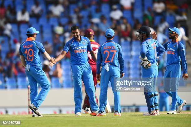 India's Ravichandran Ashwin celebrates with teammates after dismissing West Indies' Miguel Cummins during the third One Day International match...