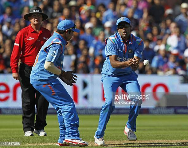 Indias Ravichandran Ashwin drops the chance to catch out Englands Joe Root watched by Indias Karn Sharma during the T20 international cricket match...