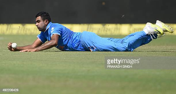 India's Ravichandran Ashwin fields a shot from South Africa's captain AB de Villiers during the first one day international cricket match between...