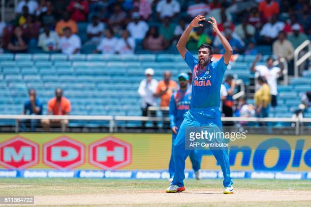 India's Ravichandran Ashwin reacts after bowling during the T20 match between West Indies and India at the Sabina Park Cricket Ground in Kingston...