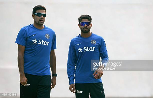 India's Ravichandran Ashwin talks with Ravindra Jadeja in the nets during a training session on the eve of the first Test match between India and...
