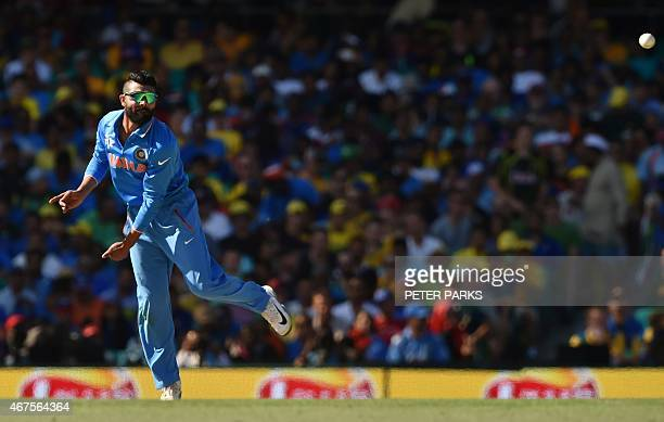 India's Ravindra Jadeja bowls during the 2015 Cricket World Cup semifinal match between Australia and India in Sydney on March 26 2015 AFP PHOTO /...