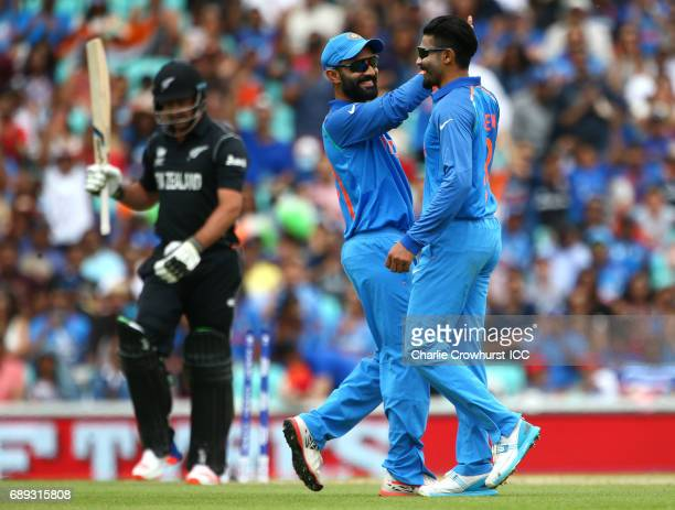 India's Ravindra Jadeja celebrates after taking the wicket of Colin de Grandhomme of New Zealand during the ICC Champions Trophy Warmup match between...