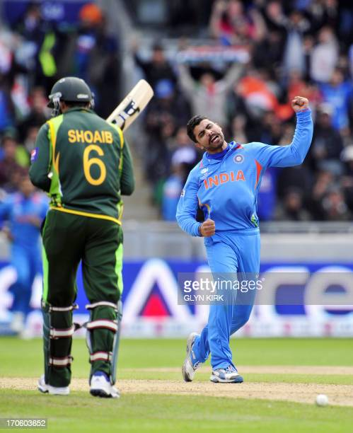 India's Ravindra Jadeja celebrates trapping Pakistan's Shoaib Malik LBW for 17 runs during the 2013 ICC Champions Trophy cricket match between...