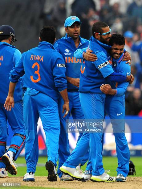 India's Ravindra Jadeja celebrates with Shikhar Dhawan after taking the wicket of Ian Bell during the ICC Champions Trophy Final at Edgbaston...