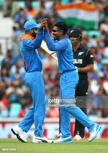 India's Ravindra Jadeja celebrates with Virat Kohli after taking the wicket of Colin de Grandhomme of New Zealand during the ICC Champions Trophy...