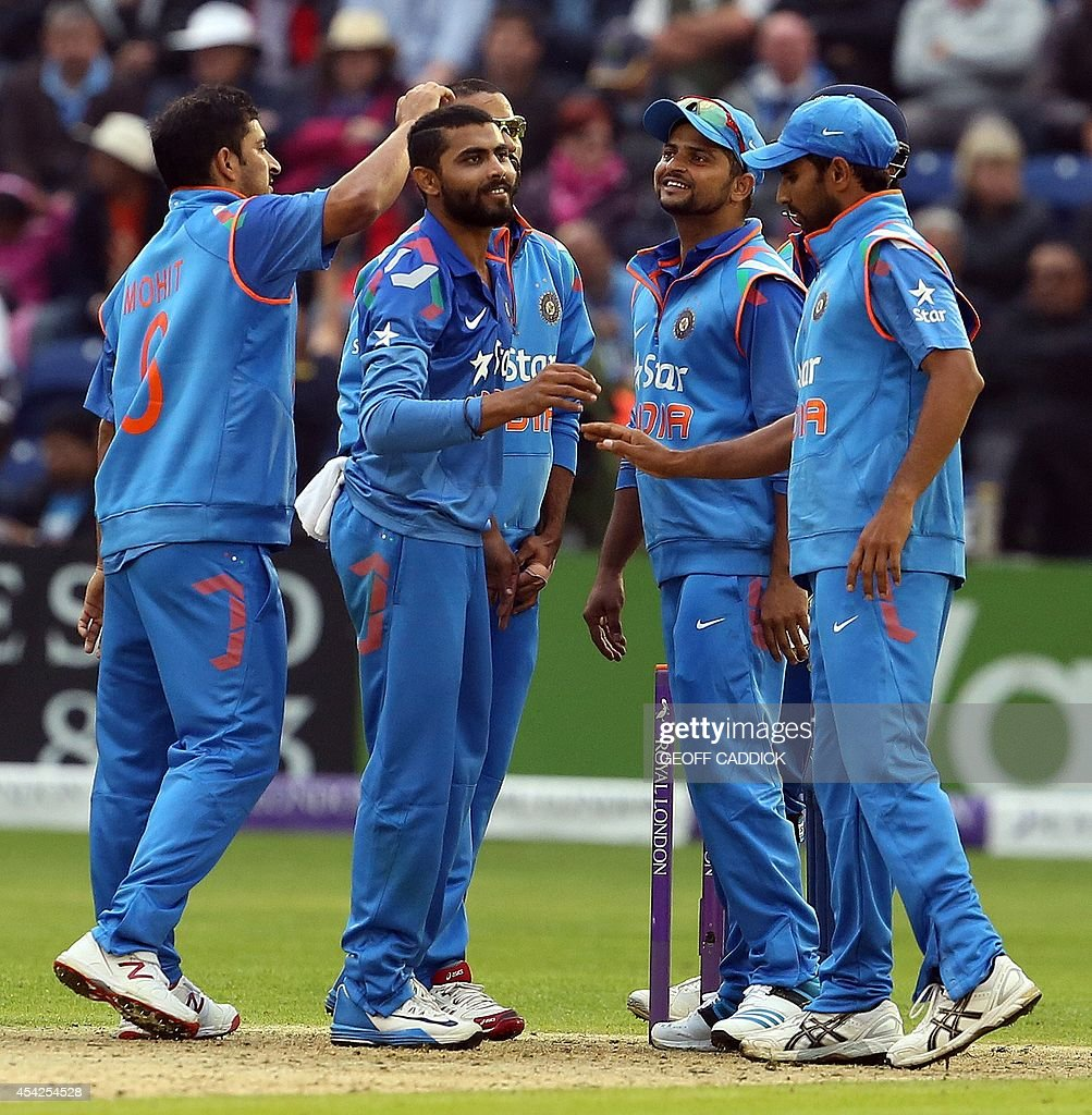 India's Ravindra Jadeja in (2L) is congratulated after taking an English wicket in the second one-day international cricket match between England and India at the Glamorgan County Cricket Ground in Cardiff, Wales on August 27, 2014. India won by 133 runs.