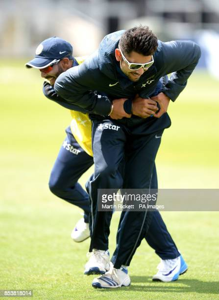 India's Ravindra Jadeja tussles with Virat Kohli during the nets session at the Emirates Old Trafford Manchester