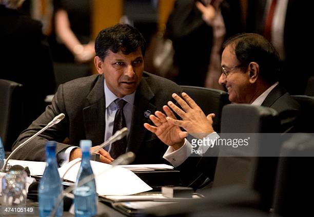India's Reserve Bank Governor Raghuram Rajan speaks with India's Finance Minister Palaniappam Chidanbarum during the opening session of the the G20...