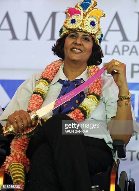 India's Rio Paralympic Games silver medalist Deepa Malik is garlanded with a crown and sword during a felicitation ceremony at a school in Chennai on...