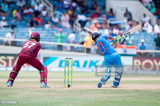 India's Rishabh Pant begins to lose his bat during a swing during the T20 match between West Indies and India at the Sabina Park Cricket Ground in...