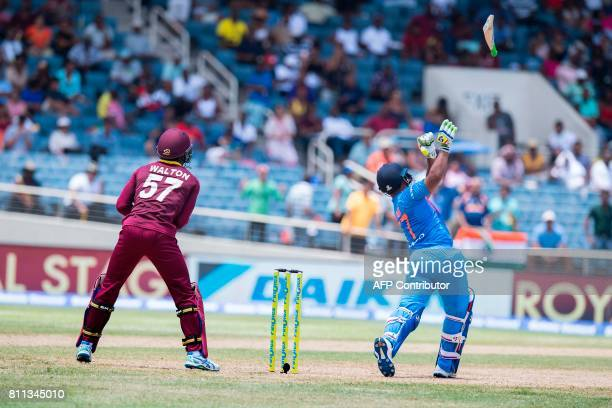 India's Rishabh Pant looses his bat during a swing during the T20 match between West Indies and India at the Sabina Park Cricket Ground in Kingston...
