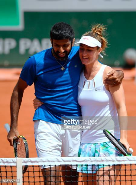 India's Rohan Bopanna and Canada's Gabriela Dabrowski celebrate after winning their mixed doubles tennis match against Colombia's Robert Farah and...