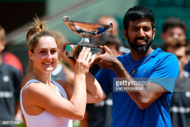 India's Rohan Bopanna and Canada's Gabriela Dabrowski pose with their trophy after winning their mixed doubles tennis match against Colombia's Robert...