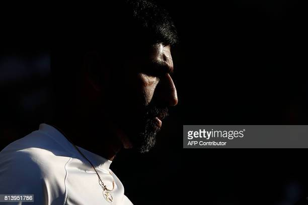 India's Rohan Bopanna plays with his partner Canada's Gabriela Dabrowski against Finland's Henri Kontinen and Britain's Heather Watson return against...