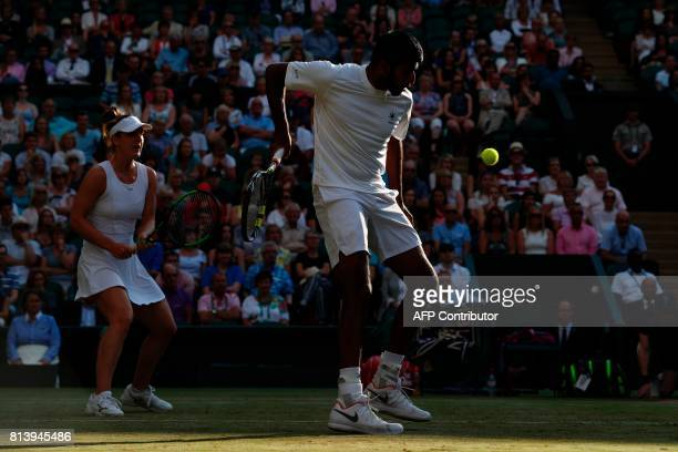 India's Rohan Bopanna returns as his partner Canada's Gabriela Dabrowski stands by against Finland's Henri Kontinen and Britain's Heather Watson...