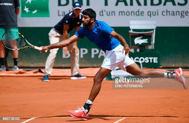 India's Rohan Bopanna returns the ball during the mixed doubles tennis final with Canada's Gabriela Dabrowski against Colombia's Robert Farah and...