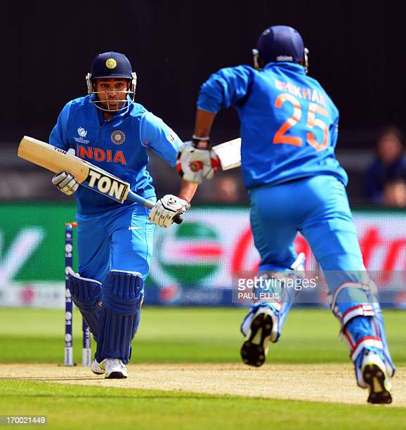 India's Rohit Sharma and Shikhar Dhawan run during the 2013 ICC Champions Trophy cricket match between India and South Africa at The Cardiff Wales...