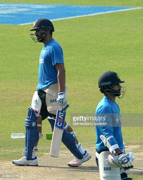 India's Rohit Sharma and Shikhar Dhawan wait for their turn to bat in the nets during a training session at The Eden Gardens Cricket Stadium in...