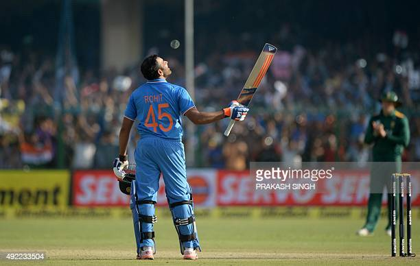 India's Rohit Sharma cekebrates after scoring a century during the first one day international cricket match between India and South Africa at Green...