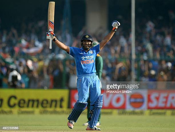 India's Rohit Sharma celebrates after scoring a century during the first one day international cricket match between India and South Africa at Green...