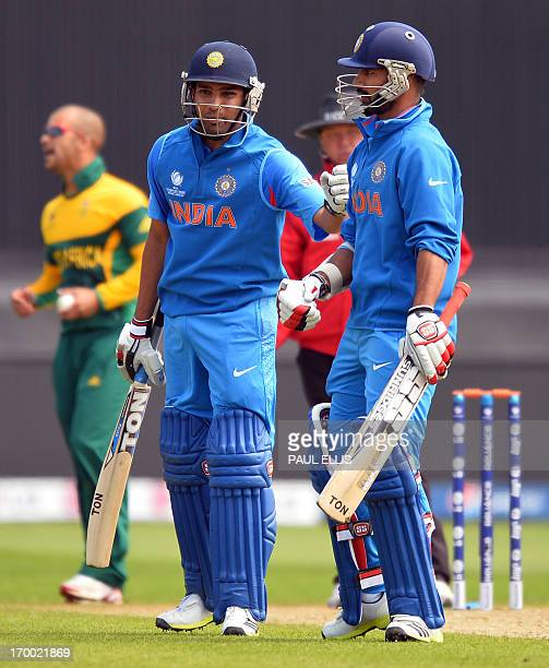 India's Rohit Sharma celebrates his half century with Shikhar Dhawan during the 2013 ICC Champions Trophy cricket match between India and South...