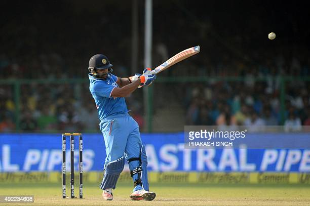 India's Rohit Sharma plays a shot during the first one day international cricket match between India and South Africa at Green Park Stadium in Kanpur...