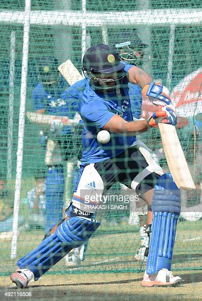 India's Rohit Sharma plays a shot in nets during a training session on the eve of the first one day international cricket match between India and...