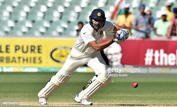 India's Rohit Sharma plays a shot on the third day of the first Test cricket match between Australia and India at the Adelaide Oval on December 11...