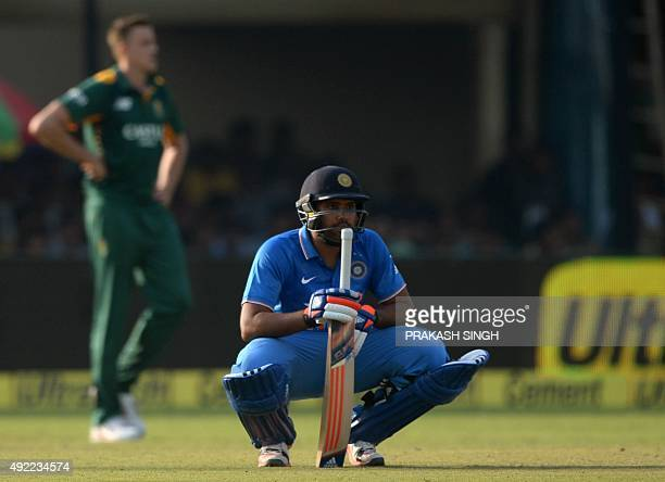 India's Rohit Sharma rests during the first one day international cricket match between India and South Africa at Green Park Stadium in Kanpur on...