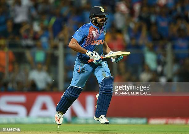 India's Rohit Sharma runs between the wickets during the World T20 cricket tournament second semifinal match between India and West Indies at The...