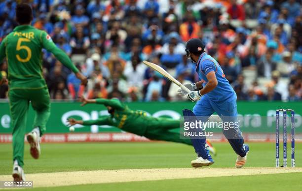 India's Rohit Sharma wwatches the ball after playing a shot for four runs during the ICC Champions trophy cricket match between India and Pakistan at...