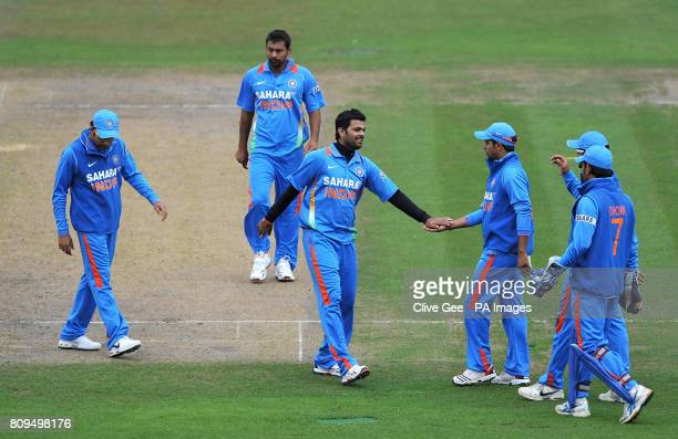 India's RP Singh is congratulated after claiming the wicket of Sussex's Chris Nash during the Tour Match at the PROBIZ County Ground Hove