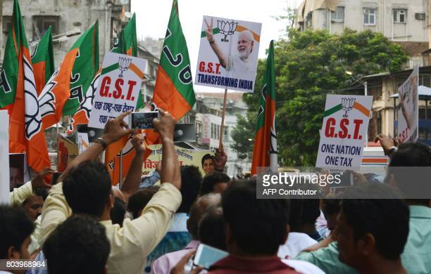 India's ruling Bharatiya Janata Party activists take part in a rally to support the new Goods and Services Tax regime in Mumbai on June 30 2017 India...