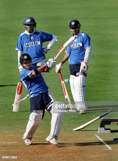 India's Sachin Tendulkar bats as captain Rahul Dravid and Virender Sehwag looks on during a practice session in Mumbai March 16 2006 India leads 10...
