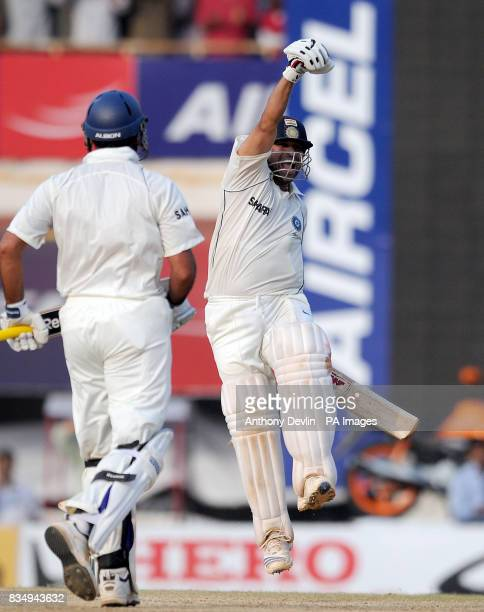 India's Sachin Tendulkar celebrates scoring 100 and winning the match during the fifth day of the First Test Match at the M A Chidambaram Stadium in...
