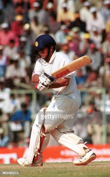 India's Sachin Tendulkar cuts Australian spinner Shane Warne for boundary on the 3rd day of third test match at Madras's MA Chidambaram stadium on...