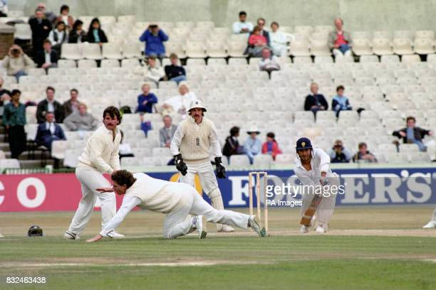 India's Sachin Tendulkar squeezes his shot past England's Allan Lamb Robin Smith and Jack Russell