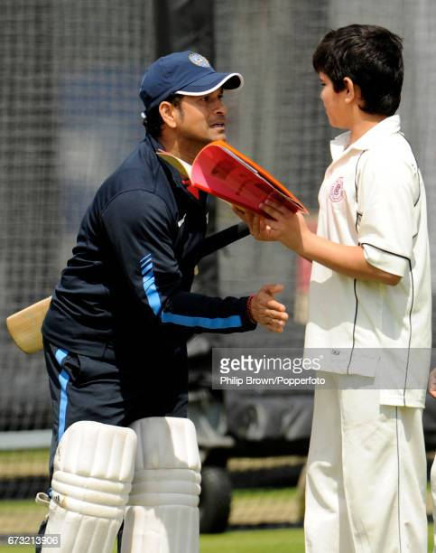 India's Sachin Tendulkar with his son Arjun during a training session before Thursday's 1st Test match against England at Lord's cricket ground in...