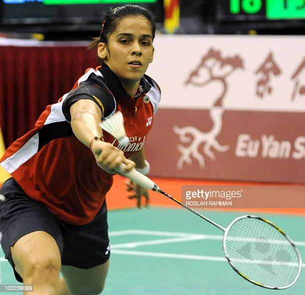 India's Saina Nehwal hits a return against Taiwan's Tai Tzu Ying during a women's single final of the Singapore Open Super Series 2010 Badminton...