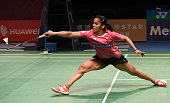 India's Saina Nehwal hits a return to China's Sun Yu during their women's singles final at the Australian Open Badminton tournament in Sydney on June...