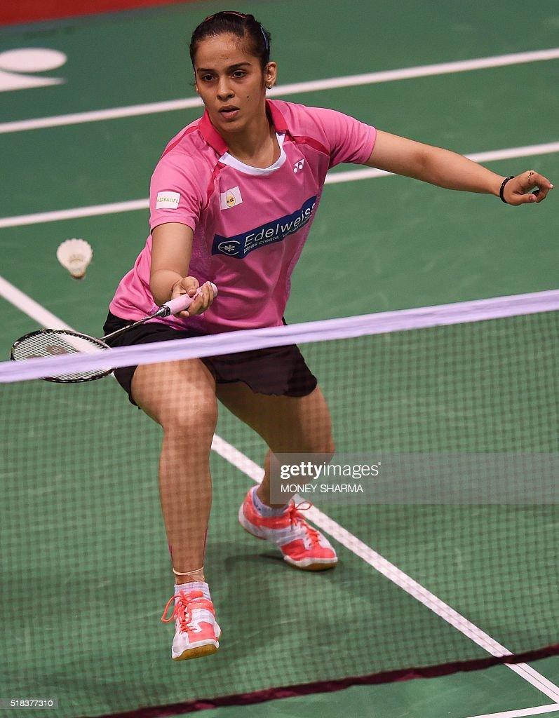 India s Saina Nehwal plays a shot against Thailand s Nitchaon