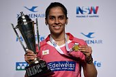 India's Saina Nehwal poses with the winner's trophy after defeating China's Sun Yu in the women's singles final at the Australian Open Badminton...