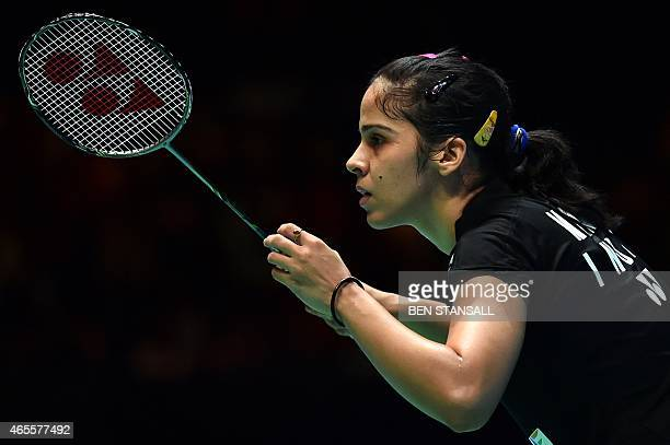 India's Saina Nehwal prepares to receive from Spain's Carolina Marin during their All England Open Badminton Championships women's singles final...