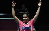 India's Saina Nehwal reacts as she celebrates her victory against China's Sun Yu in their women's singles final at the Australian Open Badminton...