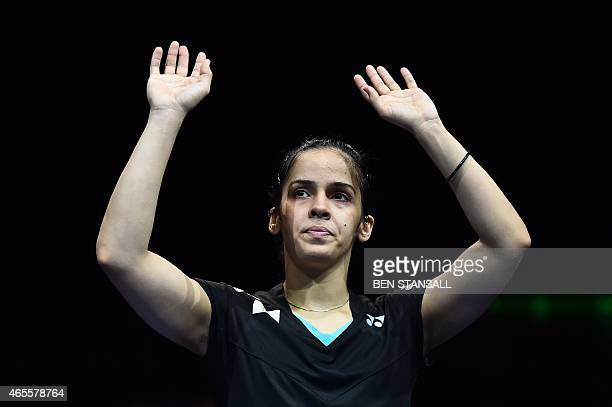 India's Saina Nehwal waves to the crowd after being defeated by Spain's Carolina Marin in their All England Open Badminton Championships women's...