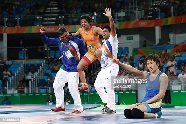 India's Sakshi Malik celebrates after winning against Kirghyzstan's Aisuluu Tynybekova in their women's 58kg freestyle bronze medal match on August...